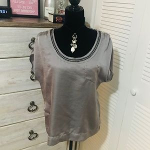 Calvin Klein Silver blouse with beaded neck line.